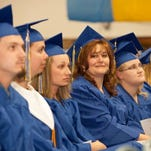 Students await their diplomas and certificates at the recent Great Falls College Montana State University graduation ceremony.