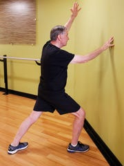 Jack Lofte demonstrates the modified Warrior I yoga