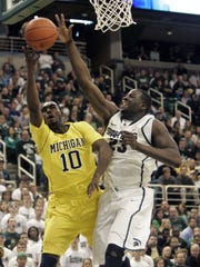 Draymond Green totaled 14 points and 16 rebounds to lead the Spartans to victory against rival Michigan on Feb. 5, 2012. Green finished 4-3 vs. Michigan in his Spartans career.