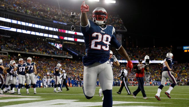 Jan 18, 2015; Foxborough, MA, USA; New England Patriots running back LeGarrette Blount (29) celebrates after scoring a touchdown during the first quarter against the Indianapolis Colts in the AFC Championship Game at Gillette Stadium. Mandatory Credit: Greg M. Cooper-USA TODAY Sports