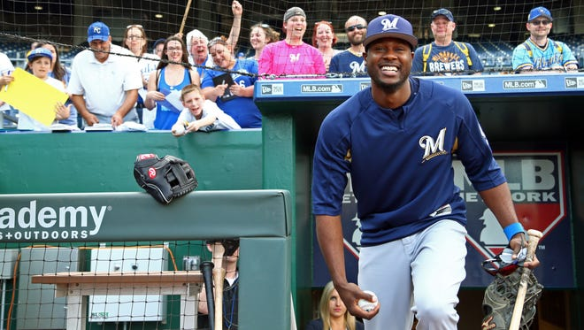 Kansas City Royals fans cheer welcome back former Royal Lorenzo Cain on Tuesday night.