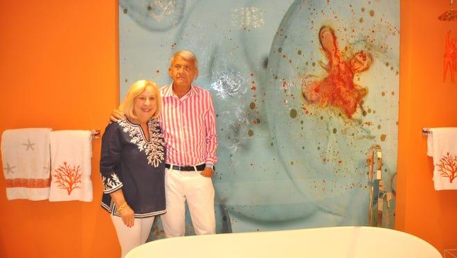 Bob and Martha Ostrowski love the decorative art panel in their master bathroom.