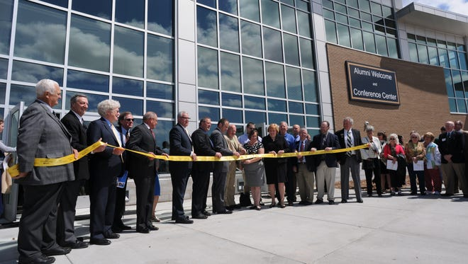 The ribbon cutting outside at the UW-Oshkosh Alumni Welcome and Conference Center in 2014.