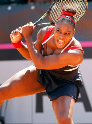 Serena Williams of United States returns the ball to Italy's Sara Errani during a Fed Cup World Group playoff tennis match in Brindisi, Italy.