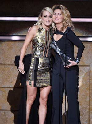 Honorees Carrie Underwood and Shania Twain embrace after Twain received the CMT Artist of a Lifetime Award at Schermerhorn Symphony Center on Oct. 19, 2016. Twain won the CMA Entertainer of the Year trophy in 1999; Underwood hopes to do it next week.