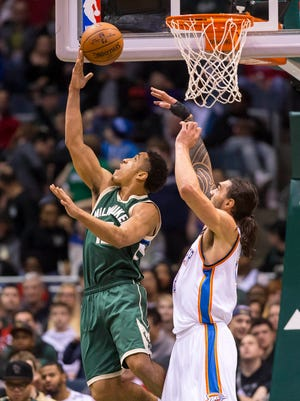 Milwaukee Bucks guard Malcolm Brogdon (13) shoots during the first quarter against the Oklahoma City Thunder at BMO Harris Bradley Center.