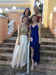 From bottom left: Emily Hermanson, Alena Burns, Upper left: Savannah Cantrell, Allie Lubas before prom.