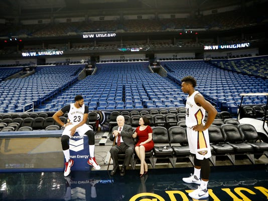 New Orleans Pelicans owner Tom Bensons and his wife Gayle Benson greet forward Anthony Davis, left, and guard Buddy Hield, right, during NBA basketball media day in New Orleans, Friday, Sept. 23, 2016. (AP Photo/Gerald Herbert)