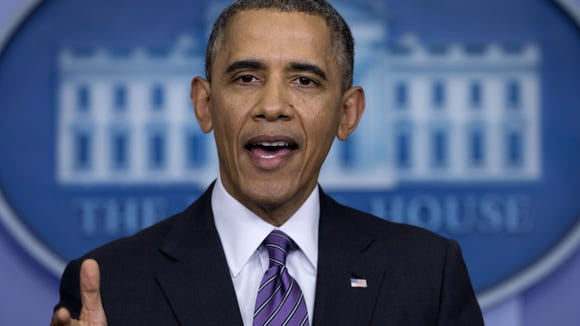 President Barack Obama speaks in the briefing room of the White House in April. A Rochester man has been charged with making threats against the president.