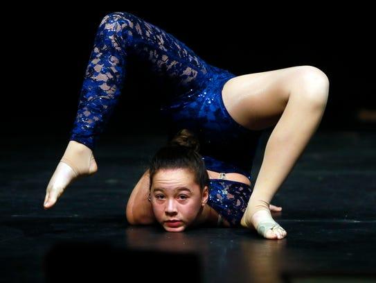 13-year-old Allison Chong of Morris Twp performs acrobatic