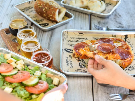 Dogfish Head's new Tasting Room & Kitchen at the Milton brewery offers beer-infused eats, flights and fresh salads.