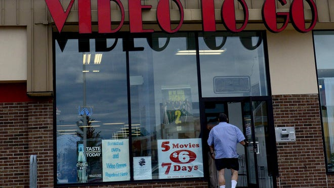 Customers walk into Video To Go on Sept. 29, 2015. Video To Go, in Frandor, is closing after more than 30 years in business.
