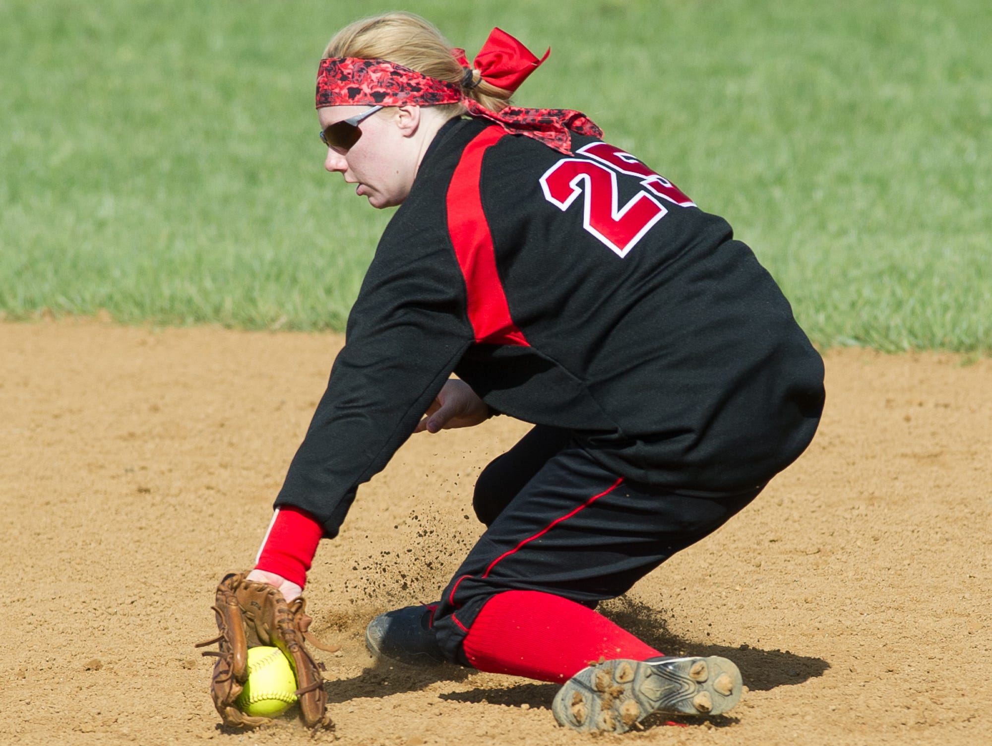 Red Lion's Taylor Beres (25) catches a ground ball hit in their game against Lake Forest.