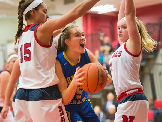 Northern Lebanon's Liz Voight  fights her way between New Oxford's Haley Luckabaugh and New Oxford's Haley Still as Northern Lebanon defeated New Oxford 53-38 to win the Lebanon girls basketball holiday tournament Dec. 28, 2016.