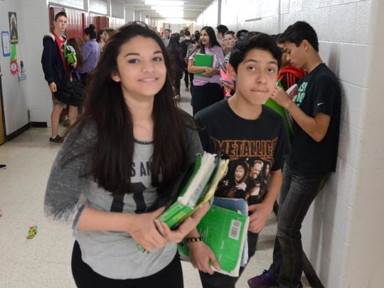 Hillside Middle School students Anjali Balusa (left) and Angel Cabaloers walk the hallways during a class change. A Northville Public Schools study committee is recommending a $39.8 million replacement for Hillside be built just west of the existing school.