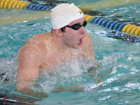 South Lyon Unified's Brandon Bell wins the 100 butterfly