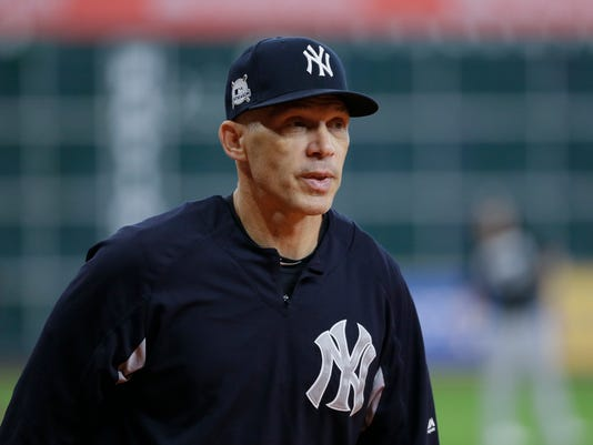 New York Yankees manager Joe Girardi watches batting practice before Game 2 of baseball's American League Championship Series against the Houston Astros Saturday, Oct. 14, 2017, in Houston. (AP Photo/Tony Gutierrez)