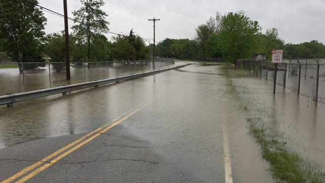 Riverwood Avenue is flooded north of 211th Street.