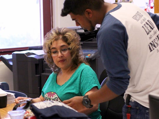 DHS Academic Adviser Yvonne Perales works with students to turn in applications for local scholarships.