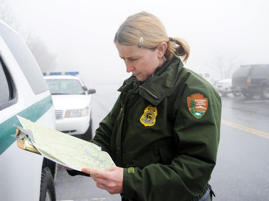 U.S. Park Ranger Tabby Cavendish looks over maps in this file photo from 2012. Rangers were searching for Derek Lueking from Blount County, Tennessee.