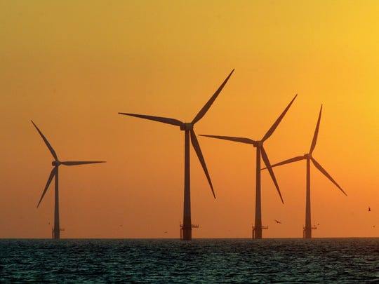 The sun starts to rise behind Britain's largest offshore wind farm off the Great Yarmouth coastline in 2006 in Norfolk, England. Maryland officials are moving forward on plans to develop offshore wind.