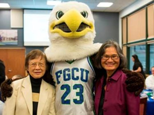 Mei-Mei Chan, right, with her mother, and Azul, the FGCU mascot.