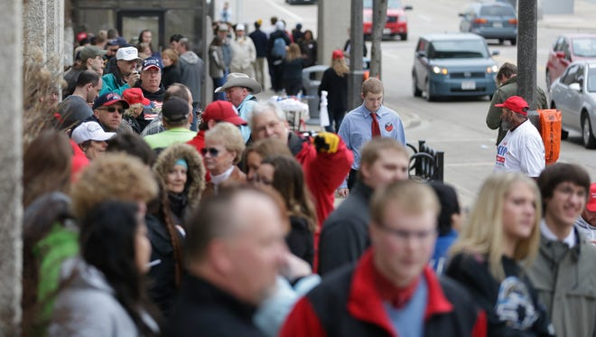 Supporters of presidential candidate Donald Trump supporters wait in line Wednesday morning for Trump's campaign stop at the Radisson Paper Valley Hotel in downtown Appleton.