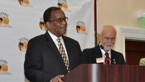 Outgoing Florida Gulf Coast University Wilson Bradshaw accepts the Estero Chamber of Commerce Person of the Year Award on Friday in Bonita Springs.