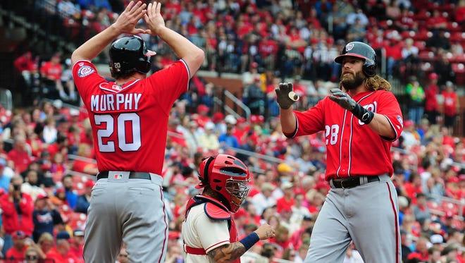 Nationals left fielder Jayson Werth is congratulated by second baseman Daniel Murphy after hitting a three-run home run.