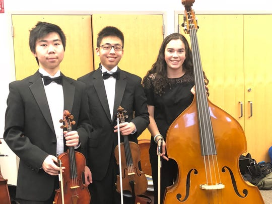 Three Westfield High School students, (l-r) Junlin Yi, Kevin Li and Kelly Eagan performed with the Central Jersey Music Educators Association Region Orchestra on Jan. 7 at the CJMEA concert held in Montgomery High School.