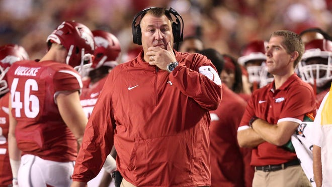 Arkansas Razorbacks head coach Bret Bielema was looking for answers during the fourth quarter against the Texas Tech Red Raiders at Donald W. Reynolds Razorback Stadium on Saturday night. Texas Tech defeated Arkansas 35-24.