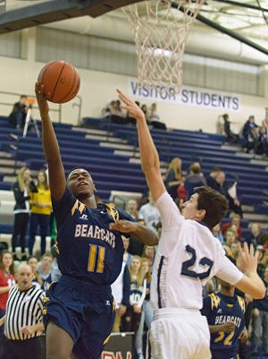 Battle Creek Central's Demetrius Craig (11) drives to the basket Friday night as the Bearcats face off against the Gull Lake Blue Devils.