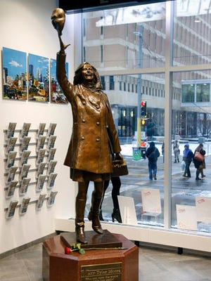 "A single rose sits by the life-size bronze statue of Mary Tyler Moore at the Minneapolis Visitor Center, Wednesday, Jan. 25, 2017. Moore, 80, died Wednesday. The statue depicts her tossing her tam into the air as she did in the opening credits of ""The Mary Tyler Moore Show."""