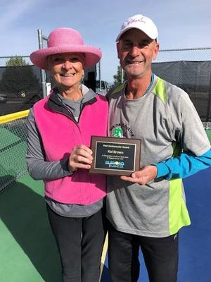 Alto Lakes Pickelball Association member Kai Brown received a past ambassador award plaque from Patrick Quist Saturday at the ALPA/Outlaw Pickleball Courts, She is the first pickleball ambassador in Lincoln County.