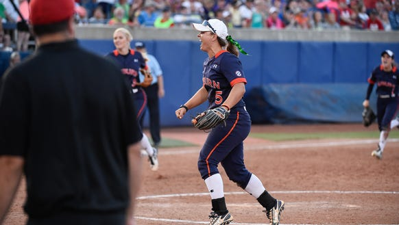 Emily Carosone (5) celebrates Auburn's 4-3 win over