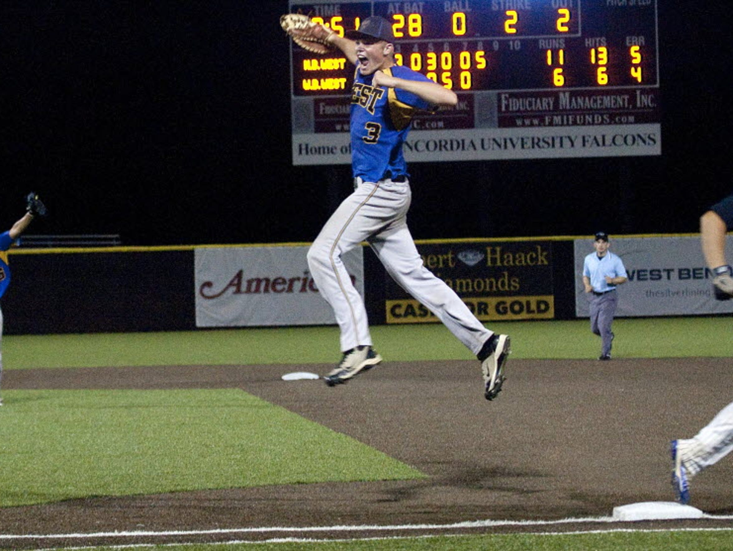 New Berlin West first baseman Andrew Knoll jumped high