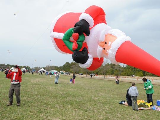 """Santa"" Jim Hintz of Newark flies his santa kite as"
