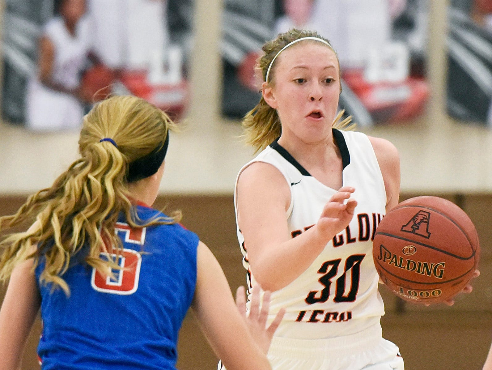 Tech's Abby Wolters breaks past Apollo's Ashley Koepp during the second half Tuesday, Dec. 8 at Apollo High School.