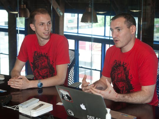 Ethen Garr (right) and Bryan Moyles, co-developers of an app to stop robocalls called RoboKiller, in their office in South Amboy.