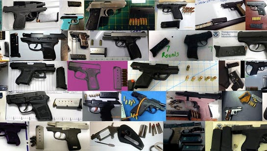 Some of the record-breaking 73 firearms TSA officers found at airport checkpoints last week.