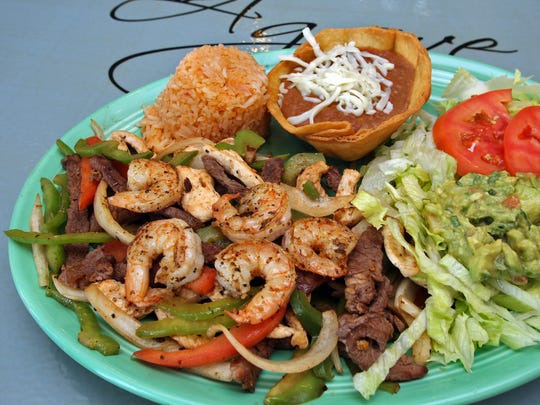 Agave shrimp and beef fajitas. Photo by BILL NEIBERGALL