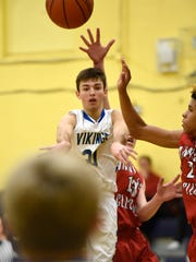 Viking Alex Yeager throws a pass to Henry Hubbard who launches a shot to score a three point shot during the Northern Lebanon match up against Annville-Cleona Friday evening, Dec. 15.