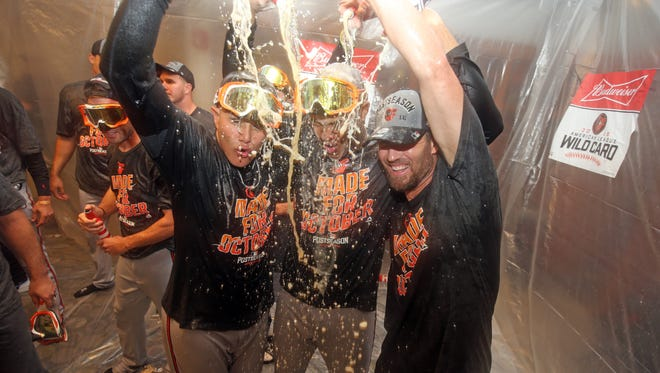 The Orioles celebrate after beating the Yankees at Yankee Stadium.