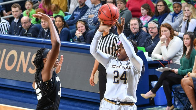 Jan 5, 2017; South Bend, IN, USA; Notre Dame Fighting Irish guard Arike Ogunbowale (24) shoots over Wake Forest Demon Deacons forward Milan Quinn (32) in the fourth quarter at the Purcell Pavilion. Notre Dame won 92-72.
