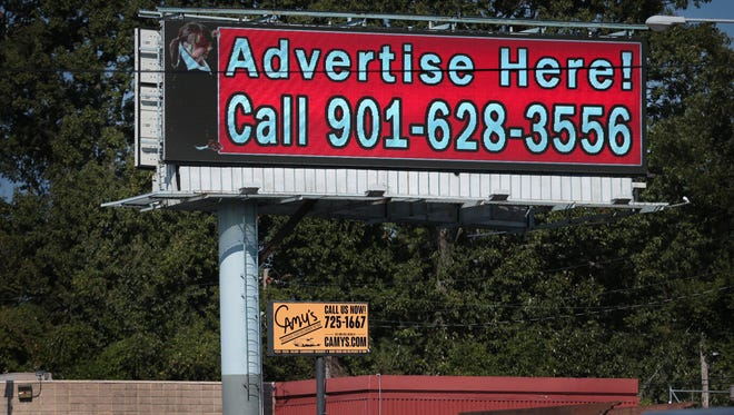 The Memphis Land Use Control Board is considering an ordinance to permit 'nonconforming billboards' allowing them to be larger or digital. This digital billboard on Walnut Grove near the viaduct flashes a new ad every 15 seconds.