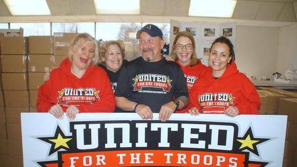 James Rathschmidt flanked by volunteers