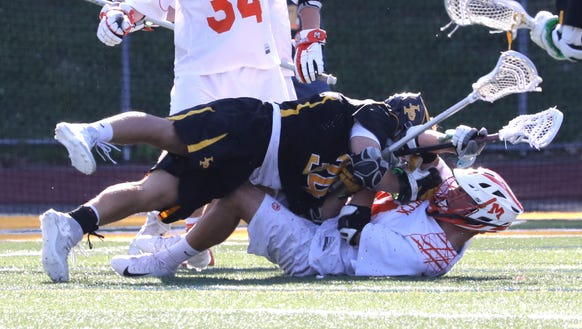 Lakeland/Panas' Sean Laukaitis lands on top of Mamaroneck's