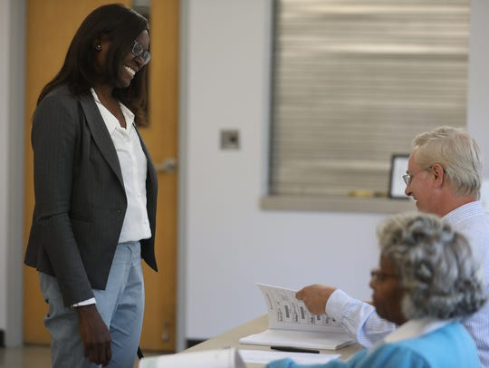Robin Wilt approaches Dana McClure, election inspector