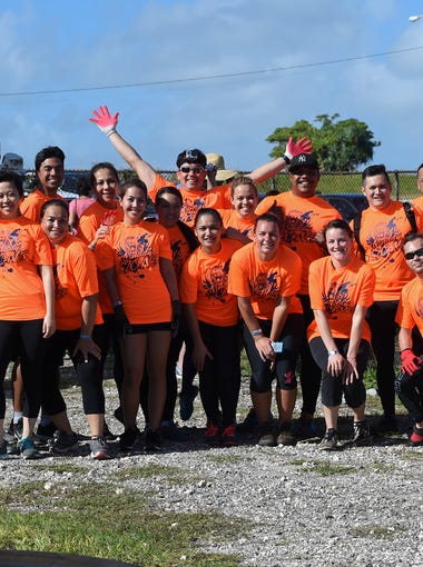 Team Muddy Lions poses for a group photo before their run in the KONQER Obstacle Course Race at the Jose and Herminia Memorial Off-Road Park in Yigo on Nov. 29.
