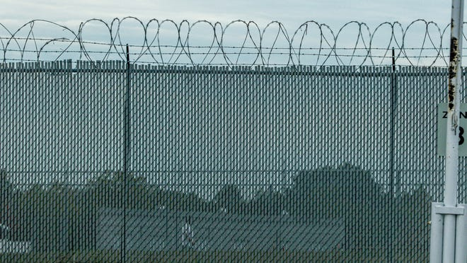 An inmate on the track of the Rhode Island Department of Corrections grounds.